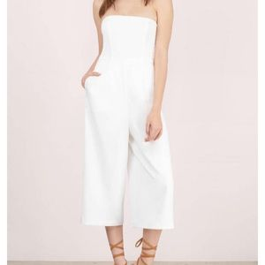 Casual and sexy white strapless jumpsuit.